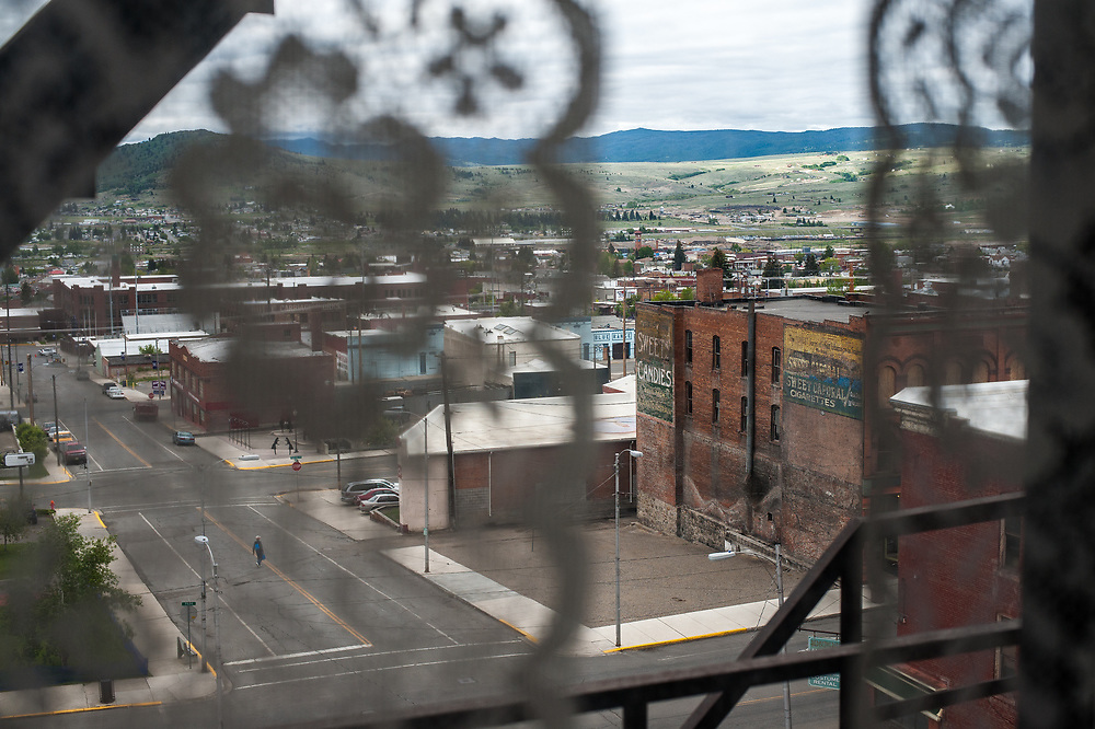View from above of Butte, Montana from a lace-curtained window in the Hotel Finlen