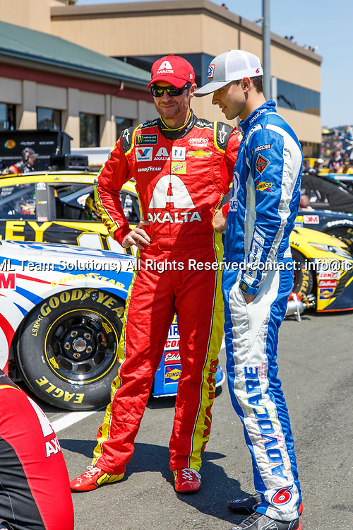 SONOMA, CA - JUNE 24: Dale Earnhardt Jr. chatting with Trevor Bayne getting ready for qualifying for the Monster Energy NASCAR Cup held at Sonoma Raceway on June 23-25, 2017. (Photo by Allan Hamilton/Icon Sportswire)