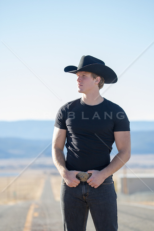 All American cowboy outdoors on a road