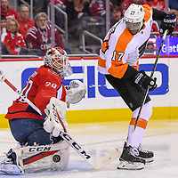 WASHINGTON, DC - JANUARY 21:  Washington Capitals goaltender Braden Holtby (70) makes a save on shot re-directed by Philadelphia Flyers right wing Wayne Simmonds (17) on January 21, 2018, at the Capital One Arena in Washington, D.C.  The Philadelphia Flyers defeated the Washington Capitals, 2-1 in overtime. (Photo by Mark Goldman/Icon Sportswire)