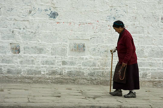 People walking around Palace praying in the city of Lhasa. Tibet.