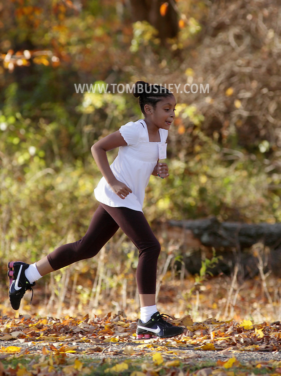 Beacon, New York - A female middle school student runs a cross country race Oct. 28, 2010.