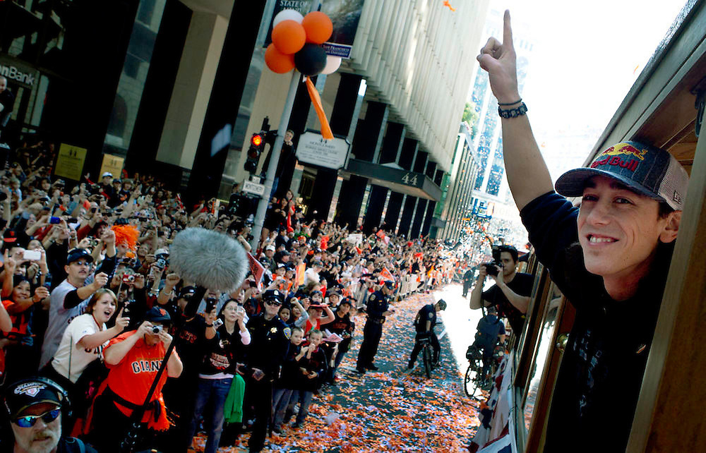 Tim Lincecum celebrates winning the World Series as he rides through the streets of San Francisco in a motorized cable car in the victory parade.