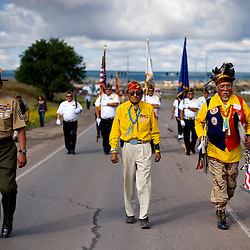 081309   Brian Leddy.Navajo Code Talker Samuel Holiday leads the parade with Gunnery Sgt. P.J. James and Larry Anderson on Friday morning. The annual parade honors the achievements of the Navajo Code Talkers during World War II.