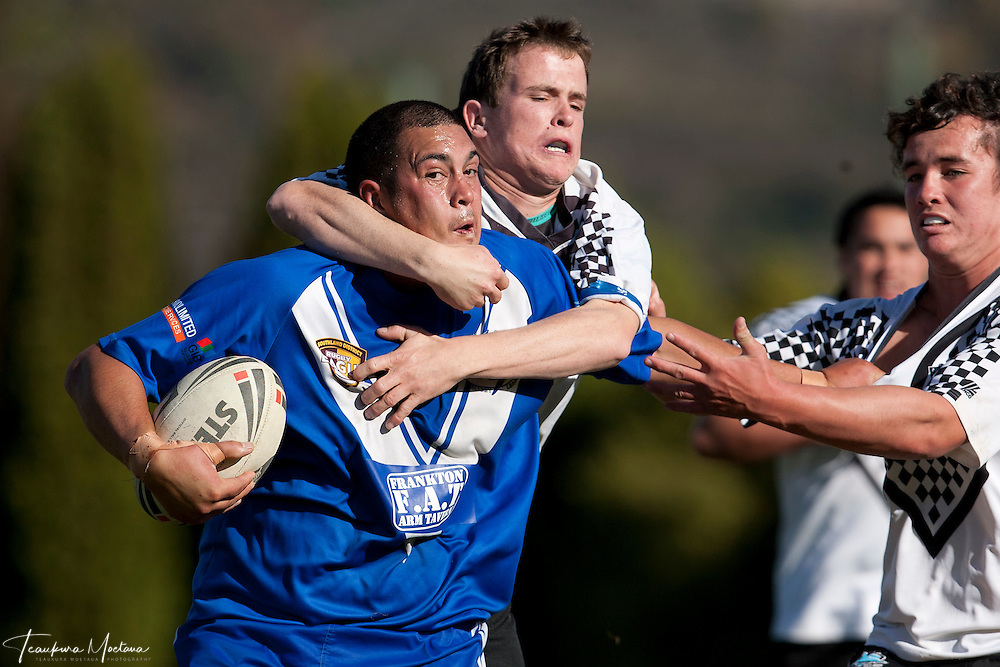 Captain William Rogers-Hoff of the Wakatipu Giants is tackled during the round three Southland District Rugby league match between the Wakatipu Giants and Winton at Queenstown Events Centre, Queenstown, New Zealand, Sunday April 22, 2012. Credit:Teaukura Moetaua / Media Sport