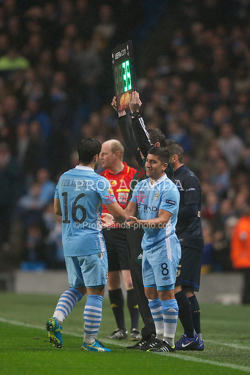 MANCHESTER, ENGLAND - Wednesday, February 22, 2012: Manchester City's Sergio Aguero is substituted for David Pizarro in action against FC Porto during the UEFA Europa League Round of 32 2nd Leg match at City of Manchester Stadium. (Pic by David Rawcliffe/Propaganda)