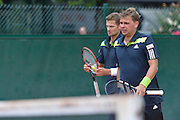 (L) Mariusz Fyrstenberg and (R) Marcin Matkowski both from Poland compete in men's doubles first round while Day Fourth during Roland Garros 2014 at Roland Garros Tennis Club in Paris, France.<br /> <br /> France, Paris, May 28, 2014<br /> <br /> Picture also available in RAW (NEF) or TIFF format on special request.<br /> <br /> For editorial use only. Any commercial or promotional use requires permission.<br /> <br /> Mandatory credit:<br /> Photo by &copy; Adam Nurkiewicz / Mediasport