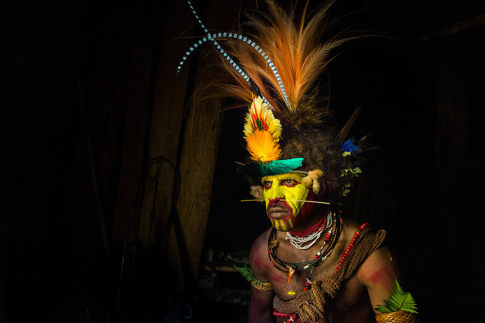 Huli wigman in his hut, Tari, PNG