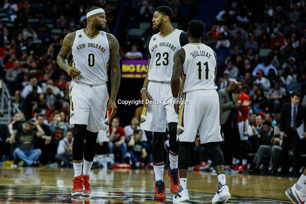 Mar 14, 2017; New Orleans, LA, USA; New Orleans Pelicans forward DeMarcus Cousins (0) and forward Anthony Davis (23) and guard Jrue Holiday (11) against the Portland Trail Blazers during the second half of a game at the Smoothie King Center. The Pelicans defeated the Trail Blazers 100-77. Mandatory Credit: Derick E. Hingle-USA TODAY Sports