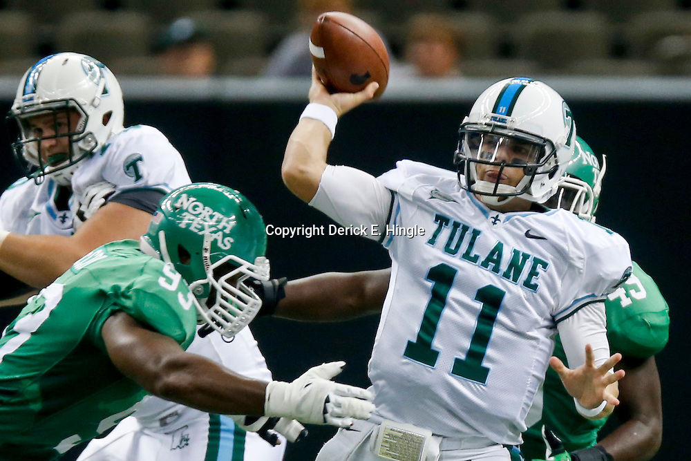 Oct 5, 2013; New Orleans, LA, USA; Tulane Green Wave quarterback Nick Montana (11) throws as North Texas Mean Green defensive end Brandon McCoy (93) pressures during the first half at Mercedes-Benz Superdome. Mandatory Credit: Derick E. Hingle-USA TODAY Sports