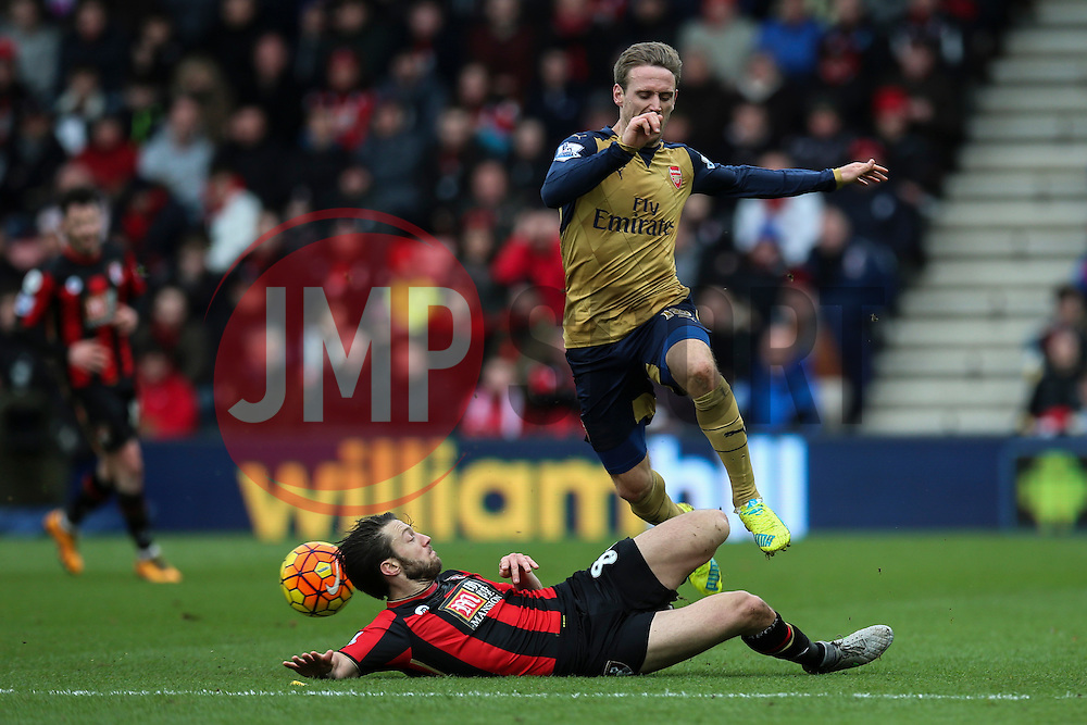 Harry Arter of Bournemouth sliding tackle on Nacho Monreal of Arsenal - Mandatory by-line: Jason Brown/JMP - Mobile 07966 386802 07/02/2016 - SPORT - FOOTBALL - Bournemouth, Vitality Stadium - AFC Bournemouth v Arsenal - Barclays Premier League