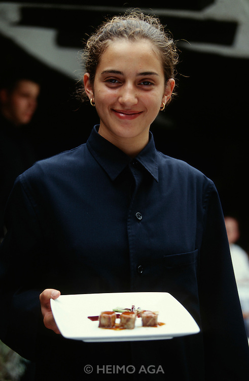 El Bulli. Famous extravagant restaurant run by Chef Ferran Adria and Manager Juli Soler. Waitress in designer costume.
