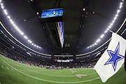 The jumbotron television screen hanging over the football field shows the final play of the game as players meet at mid field after the game in this general view photograph taken after the Dallas Cowboys 2017 NFL week 3 preseason football game against the Oakland Raiders, Saturday, Aug. 26, 2017 in Arlington, Tex. The Cowboys won the game 24-20. (©Paul Anthony Spinelli)