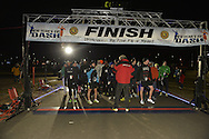 East Meadow, New York, USA. December 31, 2014. At the stroke of midnight, runners participate in a 5K New Year's Eve DASH to support the Long Island Council on Alcoholism and Drug Dependence (LICADD) at the Twin RInks Ice Center at Eisenhower Park in Long Island. A Skatin' New Year's Eve event started hours earlier and a New Year's Eve Party, open to runners, family and friends continued until 2:30 a.m.