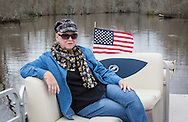 Carolyn Welsh on her boat near Bayou Corne. When the Bayou Corne sinkhole opened up on August 3, 2012 a mandatory evacuation was called and she and her husban left moving to a trailer park near by. Texas Brine drilled to close to the edge of a salt mine causing it to collapse and cause an industrial disaster.