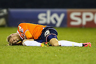 Jayden Stockley of Luton Town, currently on loan from AFC Bournemouth,  lays injured during the Sky Bet League 2 match at Kenilworth Road, Luton<br /> Picture by David Horn/Focus Images Ltd +44 7545 970036<br /> 08/01/2015