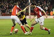 Jamie Murphy is fouled by Ben Purkiss during the Sky Bet League 1 match between Walsall and Sheffield Utd at the Banks's Stadium, Walsall, England on 17 March 2015. Photo by Alan Franklin.