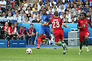 France Defender Patrice Evra battles with Portugal Midfielder Adrien Silva during the Euro 2016 final between Portugal and France at Stade de France, Saint-Denis, Paris, France on 10 July 2016. Photo by Phil Duncan.