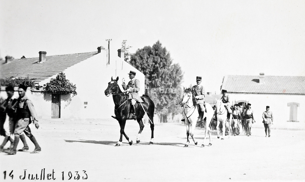 1933 Oujda Morocco - French officers on horse with Moroccan and French soldiers during a 14 July ceremony parade