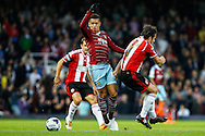 Ravel Morrison of West Ham United (centre) beats Jose Baxter of Sheffield United to the ball during the Capital One Cup match at the Boleyn Ground, London<br /> Picture by David Horn/Focus Images Ltd +44 7545 970036<br /> 26/08/2014