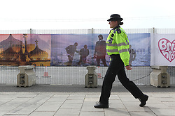 © under license to London News Pictures. 21/09/2012. A police officer walks past a security fence at the Liberal Democrats Party conference 2012 at the Brighton centre, Brighton UK. Xavier Itter/LNP
