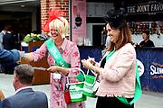 Macmillan Volunteers sell raffle tickets prior to the MacMillan Charity Raceday held at York Racecourse, York, United Kingdom on 15 June 2019.