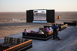 When not hurtling across the dunes in 4x4 vehicles, spectators relax on bedouin-style seating and watch the competition broadcast on big-screen televisions.