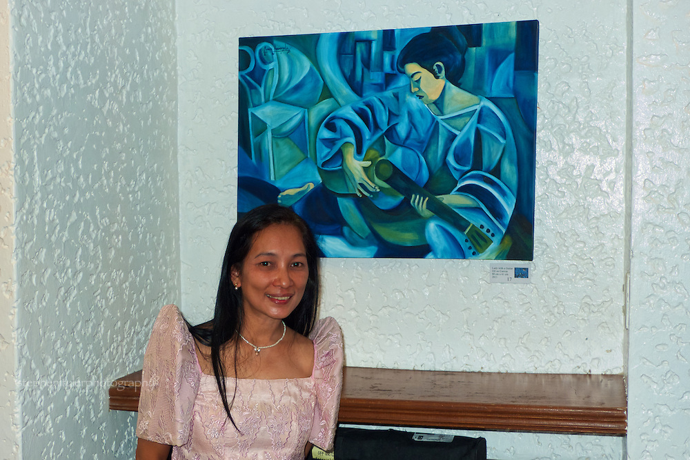 "Ronna Manansala with one of her works at the Manila German Club and Transwing Kunst Gallery's presentation during the opening night of ""Filipinism"" exhibition with fellow artist Rigor B. Esguerra."