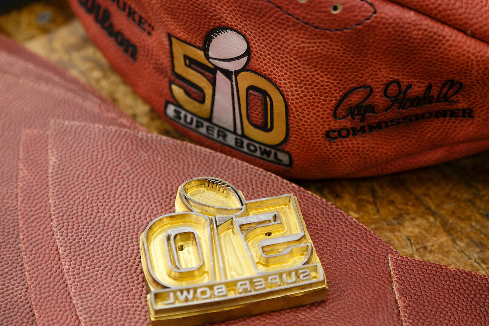 An embossing die is seen for the official ball for the NFL Super Bowl 50 football game at the Wilson Sporting Goods Co. in Ada, Ohio, Tuesday, Jan. 26, 2016. The Denver Broncos will play the Carolina Panthers in the Super Bowl on Feb. 7, in Santa Clara, CA. (AP Photo/Rick Osentoski)