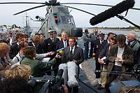 09 AUG 2001, ROSTOCK/GERMANY:<br /> Gerhard Schroeder, SPD, Bundeskanzler, und Rudolf Scharping, SPD, Bundesverteidigungsminister, waehrend einem Pressestatement auf dem Hubschrauberlandedeck des Tenders DONAU (im Hintergrund ein SEA KING Hubschrauber), waehrend einem Besuch von Marineeinheiten <br /> IMAGE: 20010809-01-019<br /> KEYWORDS: Bundeswehr, Bundesmarine, Marine, Gerhard Schröder, Kamera, Mikrofon, microphone, camera