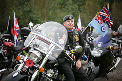 "© Licensed to London News Pictures. 3/10/2015, Tamworth, Staffordshire, UK. The eighth Ride to the Wall ""RTTW"" took place today with thousands of motorcyclists arriving at the National Memorial Arboretum. Starting at eleven designated points around the country, the riders came from all over the UK as well as continental Europe.They rode to visit the walls of the Armed Forces Memorial where the names of 16,000 service men and women are engraved to remember those killed on duty or by terrorist action since the end of the Second World War. A display by the white helmets, tiger moth flypast and memorial service formed part of the day. Pictured, ex-serviceman Rob Thomas from Bournville in Birmingham whose sons also followed him into the Armed Forces. Photo credit / Dave Warren/LNP"