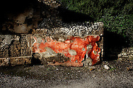 Pompei, Italia - 10 novembre 2010. Un muro caratterizzato dal famoso &quot;rosso pompeiano&quot; versa in stato di abbandono all'interno degli scavi di Pompei.<br /> Ph. Roberto Salomone Ag. Controluce<br /> ITALY - A wall lays abandoned inside the archeological site of Pompeii on November 10, 2010.