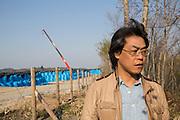 Dr. Shinzo Kimura vid ett stort omr&aring;de f&ouml;r en tillf&auml;llig lagring av radioaktiv jord i byn Shidamyo. Fukushima Prefektur, Japan<br /> <br /> Dr. Shinzo Kimura in a large area for temporary storage of radioactive contaminated soil in the village  Shidamyo. Fukushima Prefecture, Japan