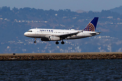 Airbus A319-132 (N894UA) operated by United Airlines landing at San Francisco International Airport (KSFO), San Francisco, California, United States of America
