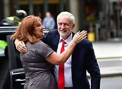 """Labour leader Jeremy Corbyn receives a hug as he arrives at Labour Party HQ in Westminster, London, after he called on the Prime Minister to resign, saying she should """"go and make way for a government that is truly representative of this country""""."""