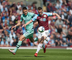 Konstantinos Mavropanos of Arsenal (L) and Chris Wood of Burnley in action - Mandatory by-line: Jack Phillips/JMP - 12/05/2019 - FOOTBALL - Turf Moor - Burnley, England - Burnley v Arsenal - English Premier League