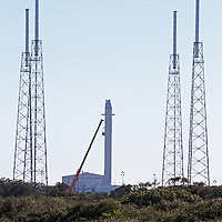 The SpaceX Falcon 9 rocket stands atop Cape Canaveral's Complex 40 launch pad after cracks were discovered on a nozzle on December 6, 2010 at Cape Canaveral, Florida. (AP Photo/Alex Menendez)
