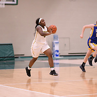 2nd year guard Kyanna Giles (9) of the Regina Cougars in action during the Women's Basketball Playoff Game on February  15 at Centre for Kinesiology, Health and Sport. Credit: Arthur Ward/Arthur Images