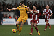 Ryan Burge of Newport County and Sam Deering of Cheltenham Town (r). Skybet football league 2 match, Newport county v Cheltenham Town at Rodney Parade in Newport, South Wales on Saturday 22nd Feb 2014.<br /> pic by Mark Hawkins, Andrew Orchard sports photography.
