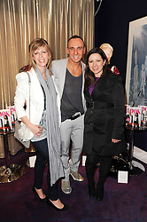 Left to right, KATE GARRAWAY, MARK HEYES and CLARE NASIR at a party to celebrate the publication of Get The Look by Mark Heyes held at the Sanctum Soho Hotel, 20 Warwick Street, London W1 on 30th March 2010.