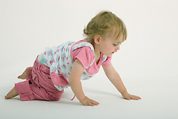 Little girl in the studio crawling,
