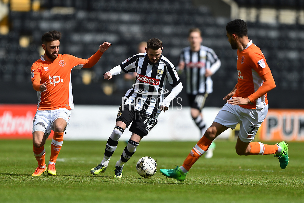Blackpool defender Kelvin Mellor (2) tackles Notts County forward Mark Yeates (10) during the EFL Sky Bet League 2 match between Notts County and Blackpool at Meadow Lane, Nottingham, England on 29 April 2017. Photo by Jon Hobley.