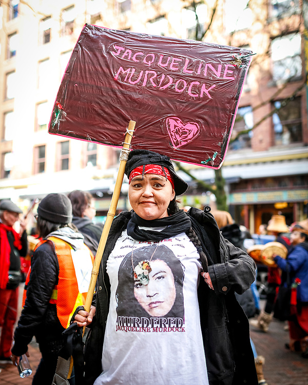 Angie Jack holds a sign for one of the women who was murdered by notorious serial killer Robert Pickton. Thousands of people took to the streets in Vancouver's Downtown Eastside Women's Memorial March, which remembers First Nations women and girls that have been murdered or gone missing.