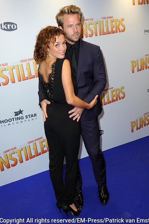 Filmpremiere Pijnstillers in Path&eacute; Tuschinski , Amsterdam<br /> <br /> Op de foto:  Katja Schuurman met haar partner Thijs Romer