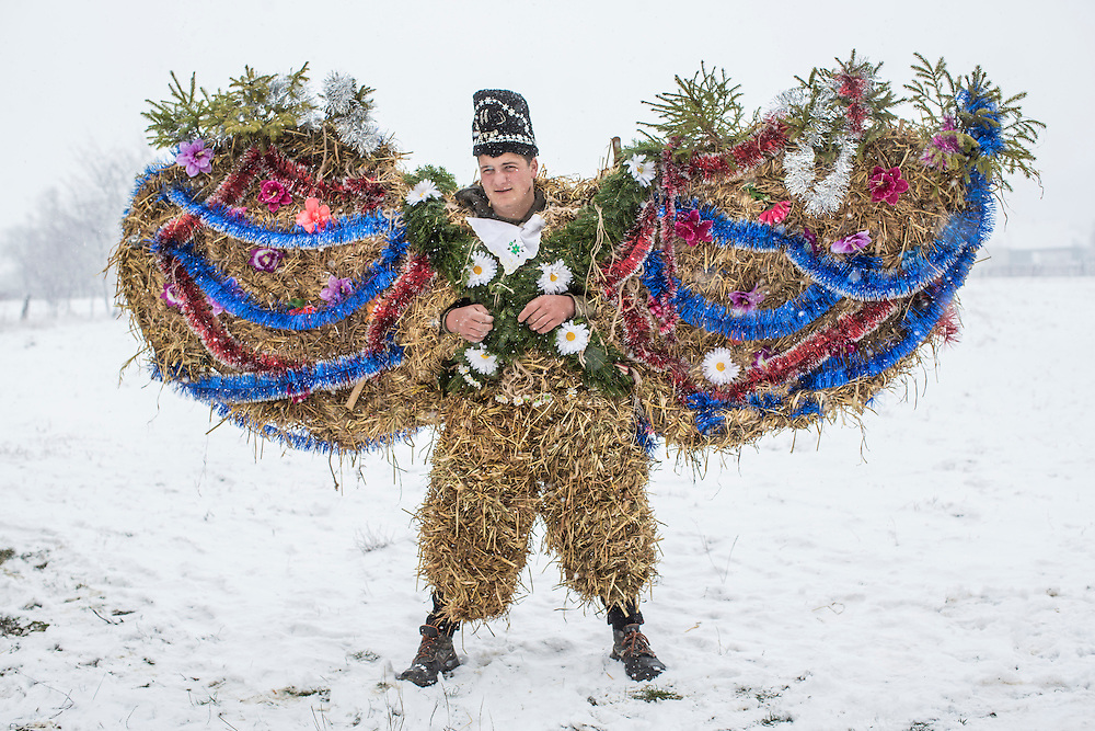 Dmytro Mytryk, 16, dressed in an elaborate bear costume, poses for a portrait during celebrations of the Malanka Festival on Thursday, January 14, 2016 in Krasnoilsk, Ukraine. The annual celebrations, which consist of costumed villagers going in a group from house to house singing, playing music, and performing skits, began the previous sundown, went all night, and will last until evening.