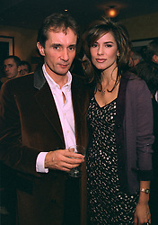 Photographer BOB CARLOS CLARKE and model MISS CHRISTINA ESTRADA, at a party in London on 22nd October 1997.MCJ 8