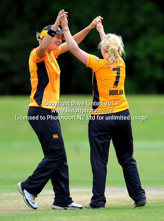 Sophie Devine (left) congratulates Blaze teammate Lucy Doolan on another wicket. Women's Twenty20 cricket - Wellington Blaze v Canterbury Magicians at Barton Oval, Upper Hutt, Wellington on Tuesday, 4 January 2011. Photo: Dave Lintott / photosport.co.nz