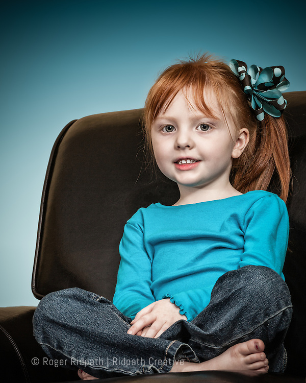 Red Headed Cute Girl With Bow Portrait