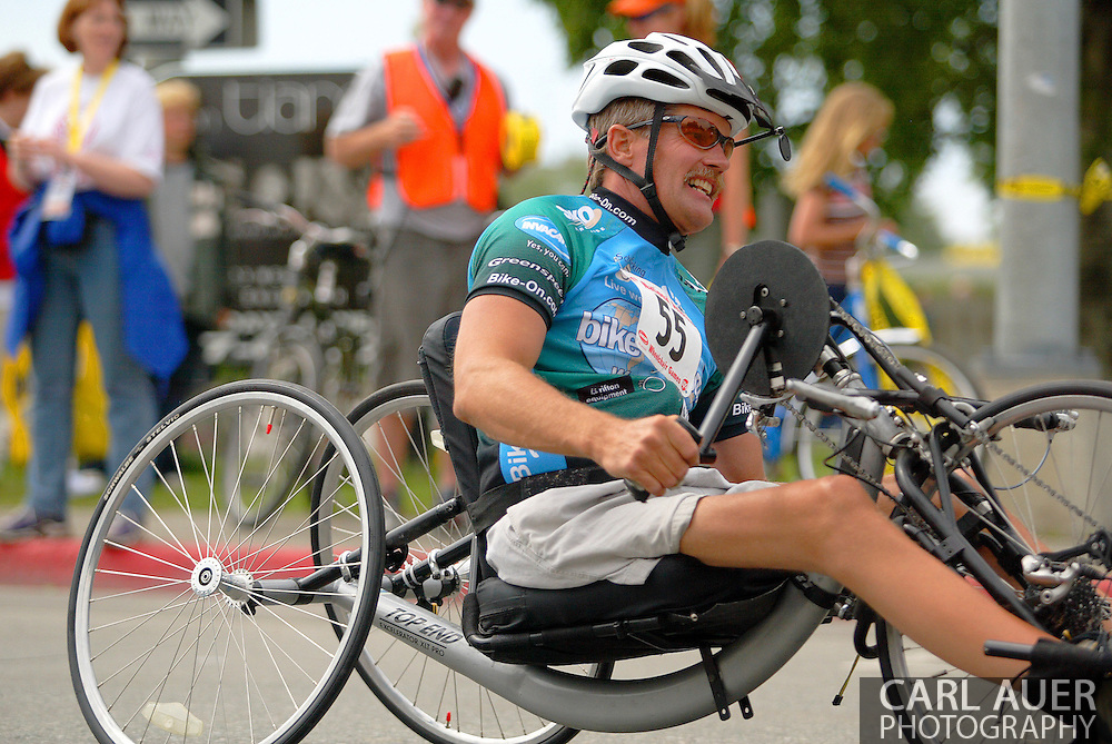 July 4th, 2006:  Anchorage, Alaska - James Freudenberg (55), a Navy veteran from Farmington, New Mexico, exits turn one of the 5k handcycle event at the 26th National Veterans Wheelchair Games..