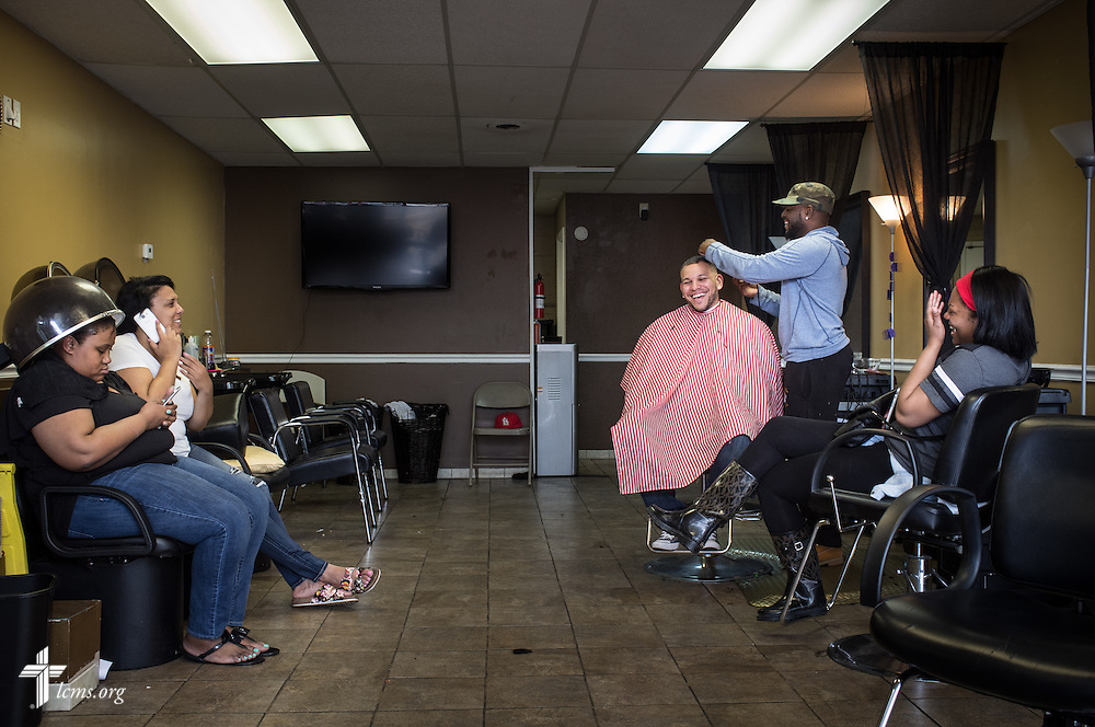 Micah Glenn, a fourth-year Master of Divinity student at Concordia Seminary, St. Louis and new national missionary to Ferguson, chats with old friends during a haircut on Wednesday, April 20, 2016, near Ferguson, Mo. LCMS Communications/Erik M. Lunsford